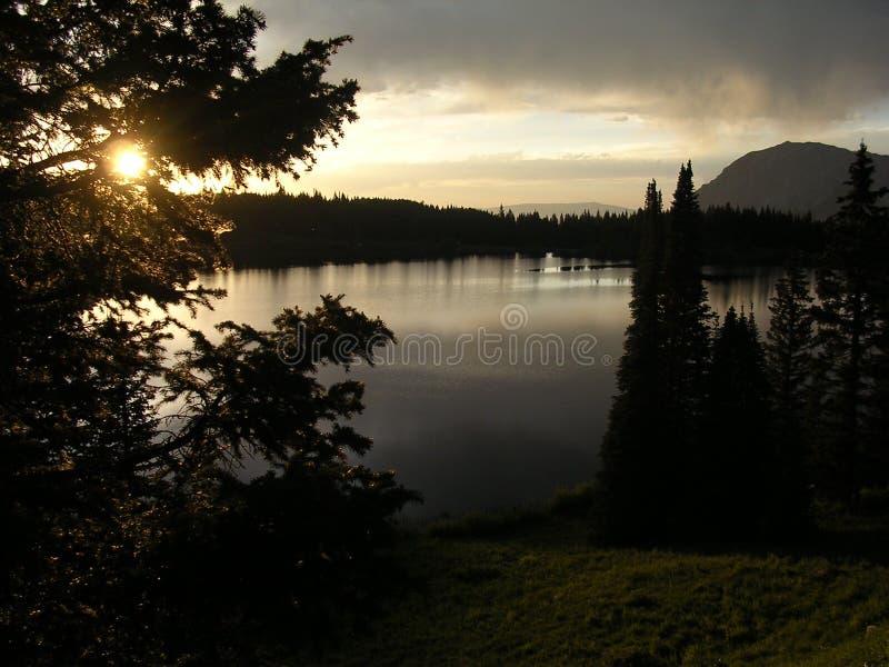 Dark Sunset on Mountain Lake royalty free stock photo
