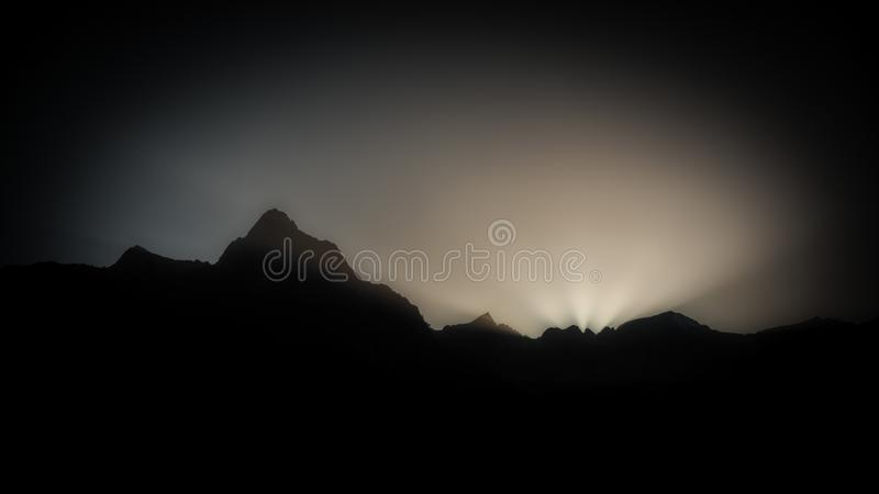 Dark sunset in the mountains stock image