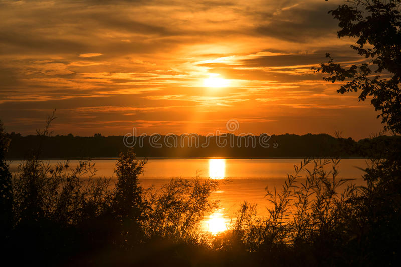 Dark sunset over the lake royalty free stock photography