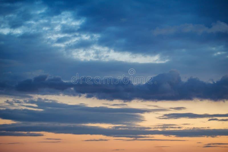 Dark sunset sky. Spectacular dramatic dark sky at sunset with clouds horizon on evening natural background royalty free stock photos