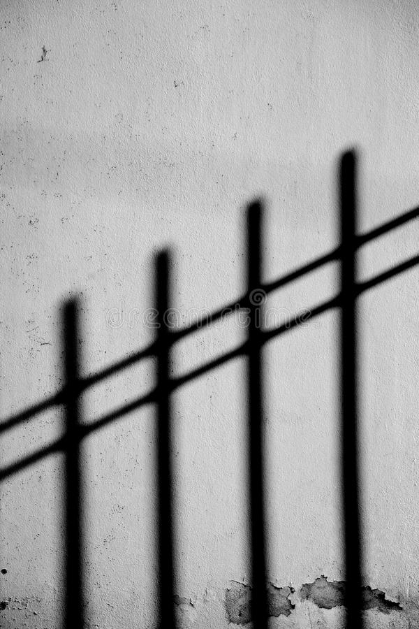 Fence casts shadows royalty free stock photography