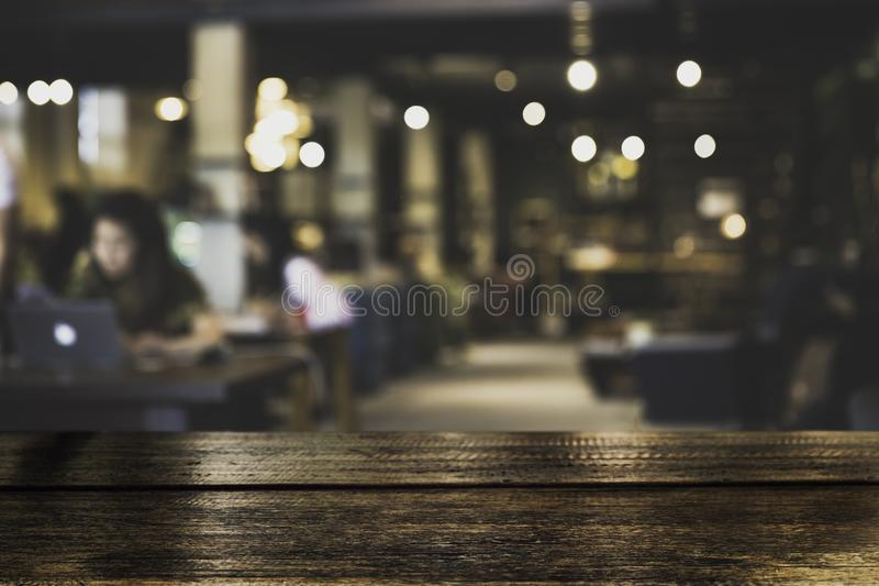 Dark Table top Counter with blurred of coffee shop or modern library. Dark Table top Counter with blurred of coffee shop or modern library . Abstract stock photo