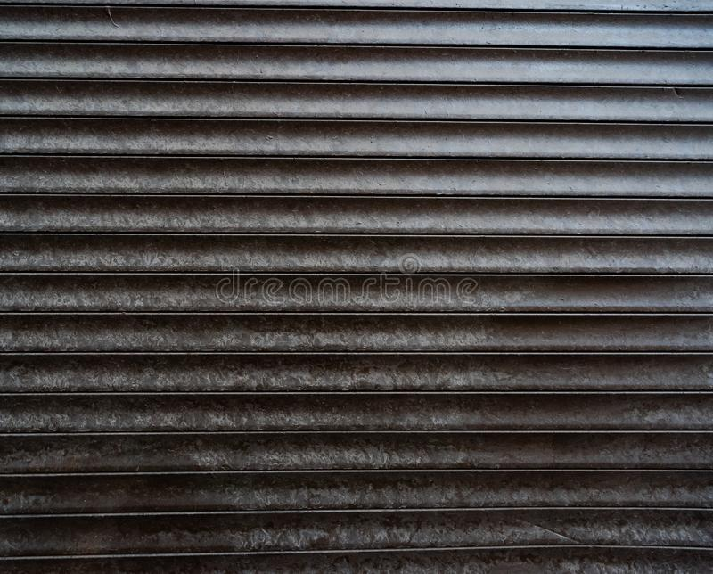 Dark texture of closed metal shutters royalty free stock images