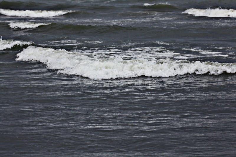 Dark texture of storm sea. Waves stock photography
