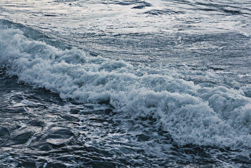 Dark texture of storm sea. Waves royalty free stock image