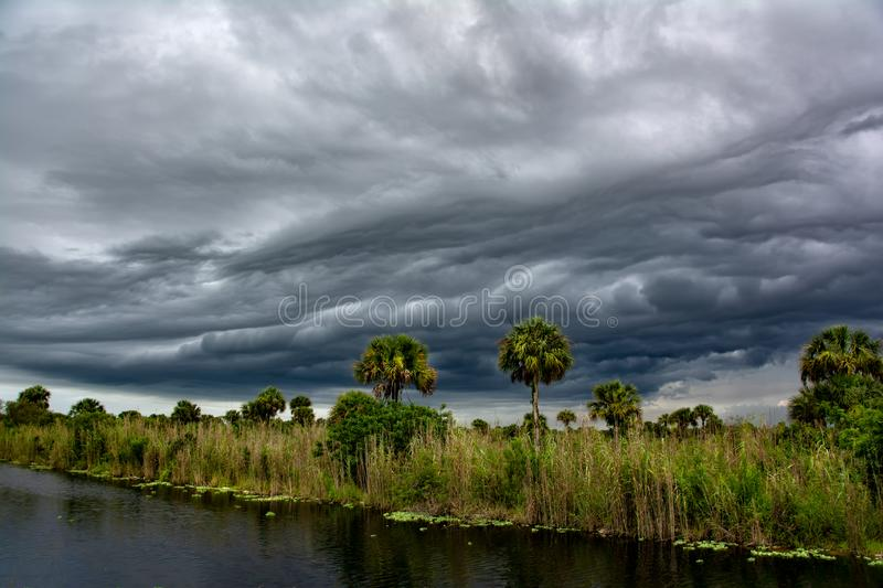 Dark thunder clouds and dramatic storms fill the sky over the sw. Amp in Big Cypress, Florida stock images