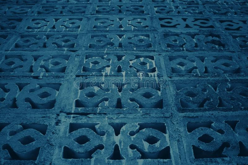 Dark tone background with many patterned bricks, rectangular shapes and straight lines. For the wallpapers stock photography