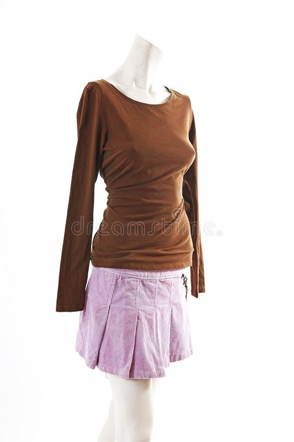 Dark top and purple mini skirt summer spring wear on mannequin full body shop display. Woman fashion styles, clothes on royalty free stock photo