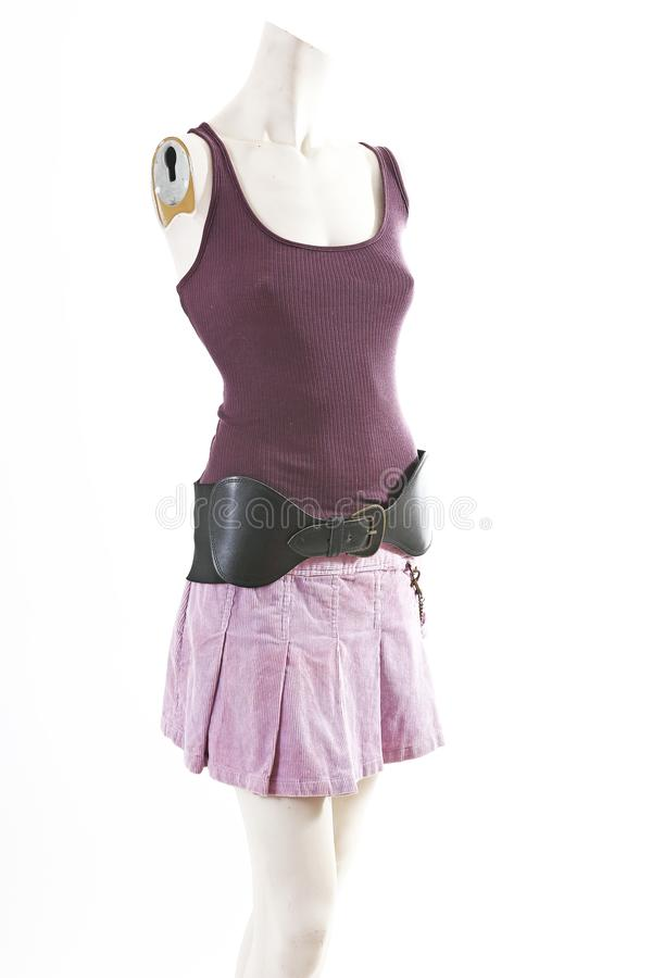 Dark top and purple mini skirt summer spring wear on mannequin full body shop display. Woman fashion styles, clothes on stock images