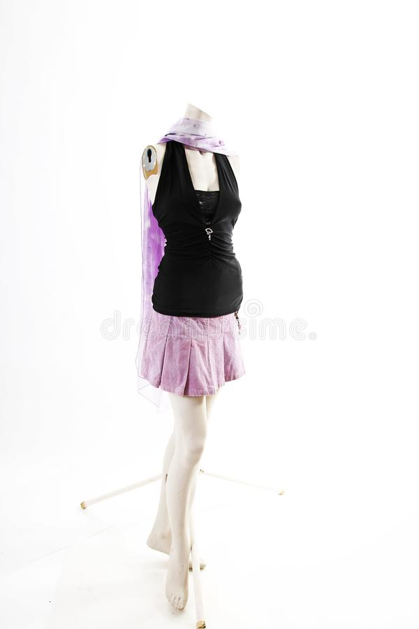 Dark top and purple mini skirt summer spring wear on mannequin full body shop display. Woman fashion styles, clothes on white stud stock photo