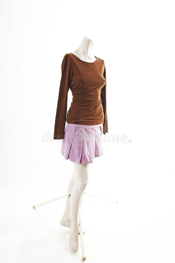 Dark top and purple mini skirt summer spring wear on mannequin full body shop display. Woman fashion styles, clothes on white stud royalty free stock image