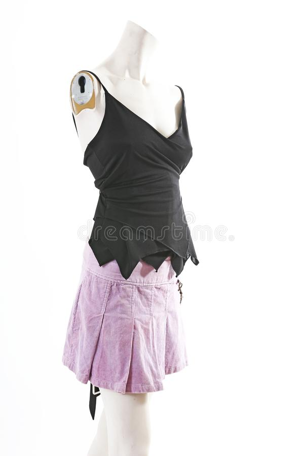 Dark top and purple mini skirt summer spring wear on mannequin full body shop display. Woman fashion styles, clothes on white stud royalty free stock photo
