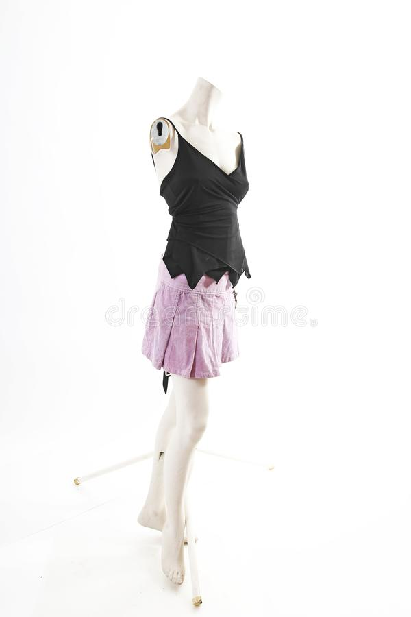 Dark top and purple mini skirt summer spring wear on mannequin full body shop display. Woman fashion styles, clothes on white stud stock images