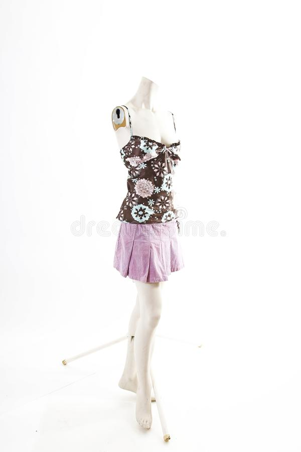 Dark top and purple mini skirt summer spring wear on mannequin full body shop display. Woman fashion styles, clothes on white stud royalty free stock images
