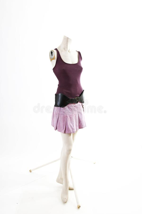 Dark top and purple mini skirt summer spring wear on mannequin full body shop display. Woman fashion styles, clothes on white stud stock photos