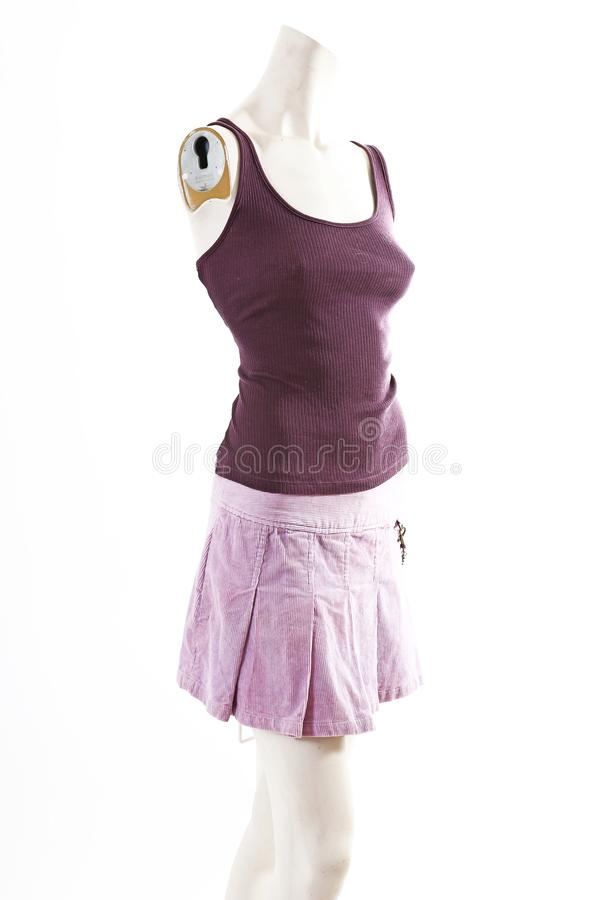 Dark top and purple mini skirt summer spring wear on mannequin full body shop display. Woman fashion styles, clothes on white stud stock image