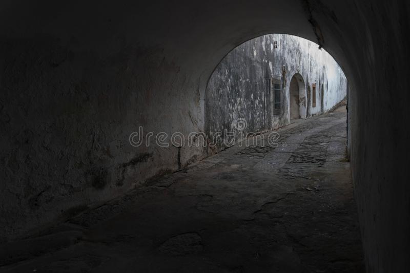 Old tunnel. Dark tunnel in fortress built in the 17th century, in Niteroi, RJ, Brazil royalty free stock images