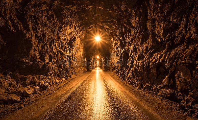 Dark tunnel in the mountain stock images