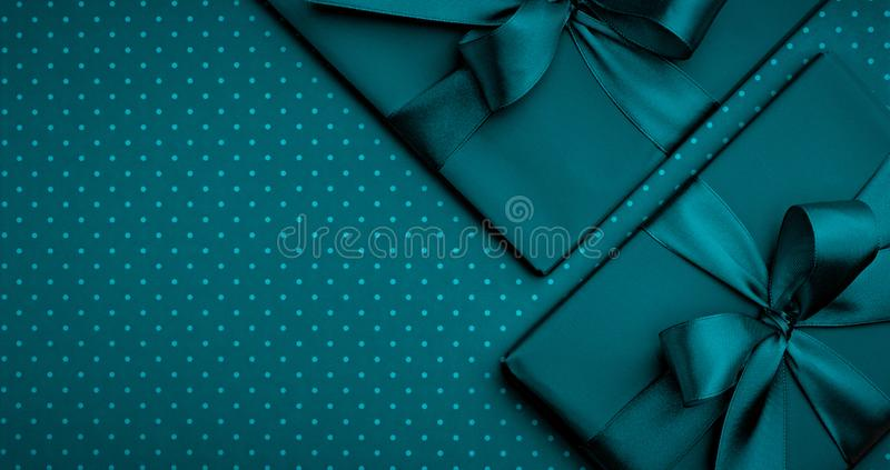 Dark turquoise gift box flat lay composition, greeting card birthday on dark turquoise background. Concept holiday present box. Decoration top view for Mothers royalty free stock image
