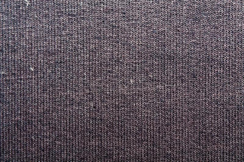 Dark violet background from a textile material with wicker closeup. Structure of the navy blue fabric with natural texture. Cloth royalty free stock photography