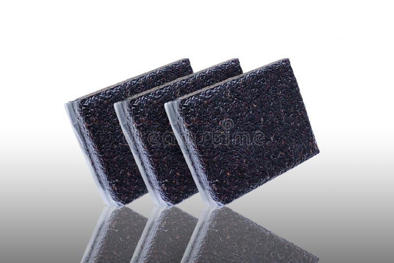 Dark violet berries rice packed in the vacuity packaging.  stock image