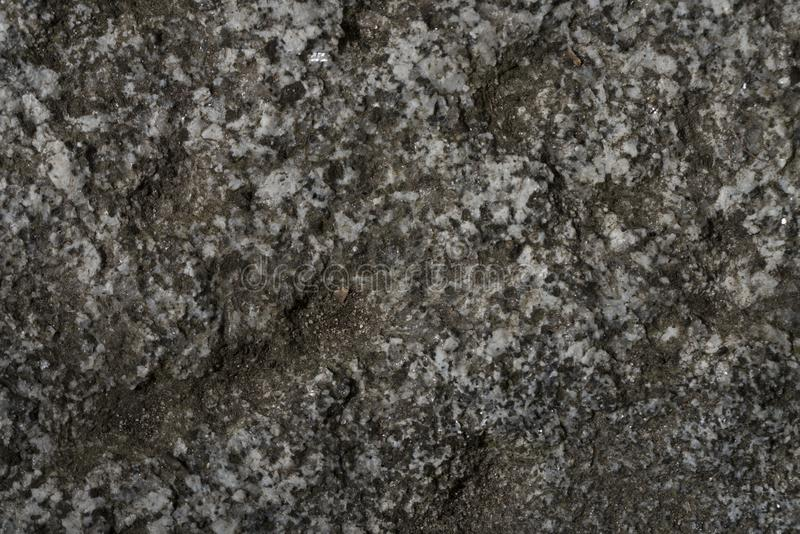 Dark weathered marble stone. For backgrounds royalty free stock photography