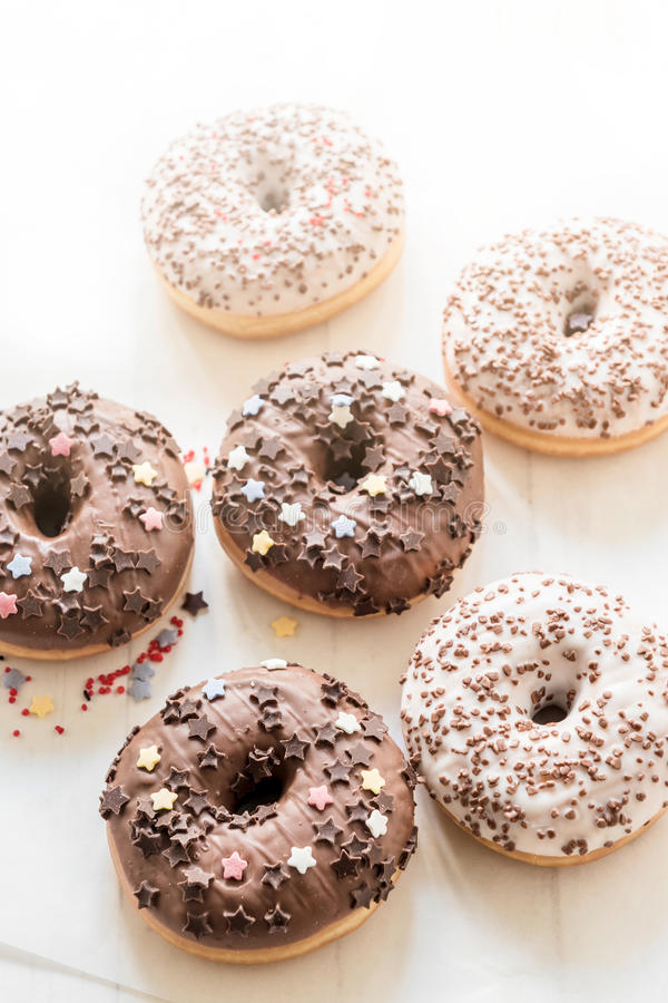 Dark and white chocolate donuts royalty free stock photography