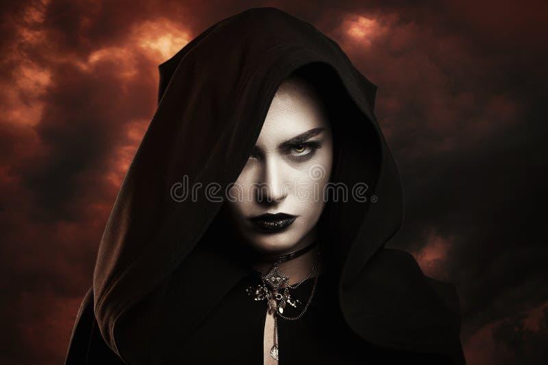 Dark witch and hellish sky. Dark witch with hellish sky . Doom`s day concept stock photo