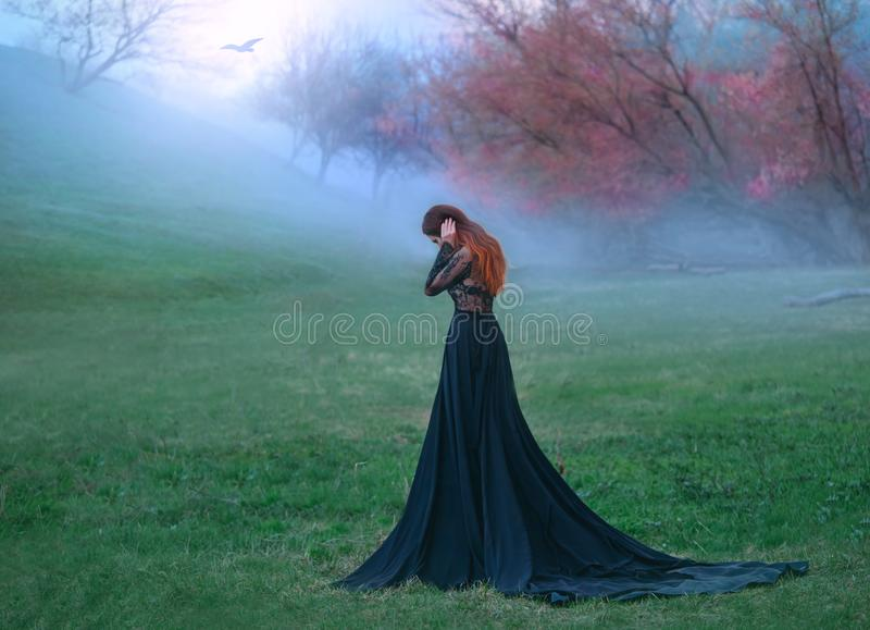Dark witch made terrible mistake, sad lady in long black dress with long tail and lace sleeves, girl with bright red stock images
