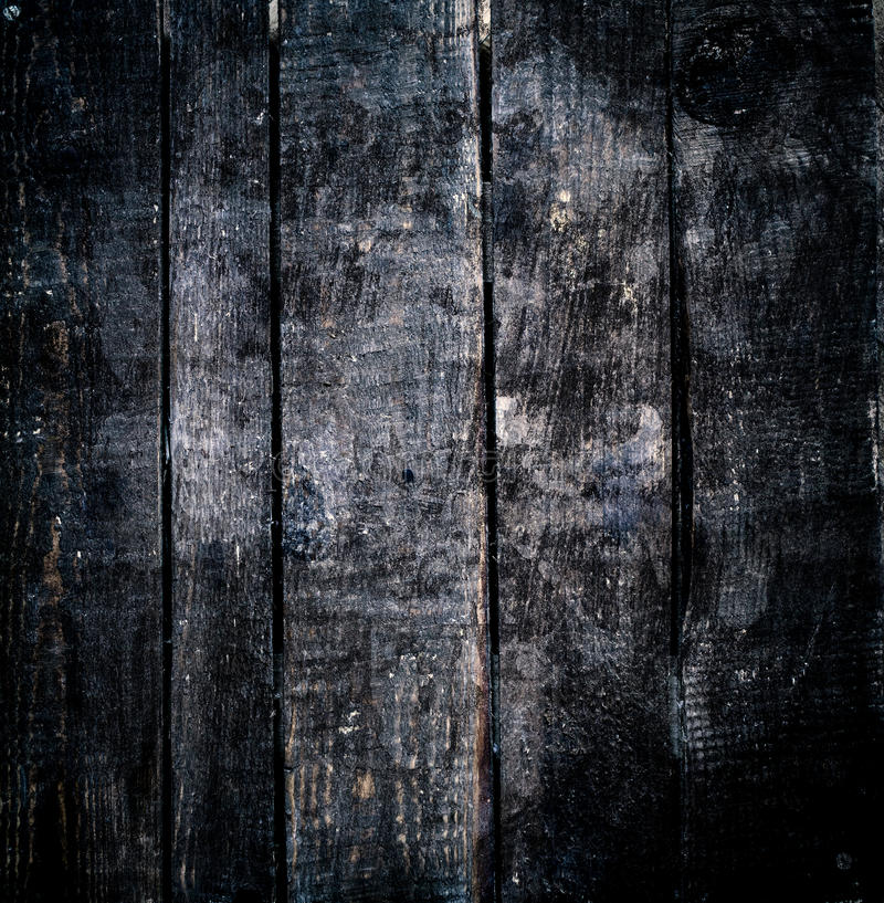 Dark wood background. Black wooden texture macro royalty free stock photos