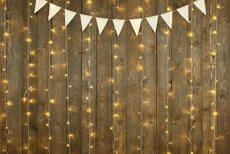 Dark wood background with lights and flags, abstract holiday backdrop, copy space for text stock photos