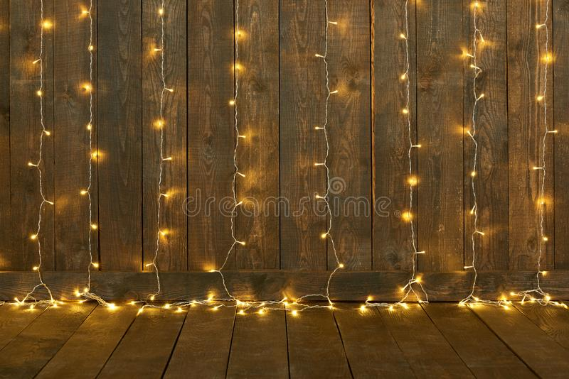 Dark wood background with lights, wall and floor, abstract holiday backdrop, copy space for text stock image