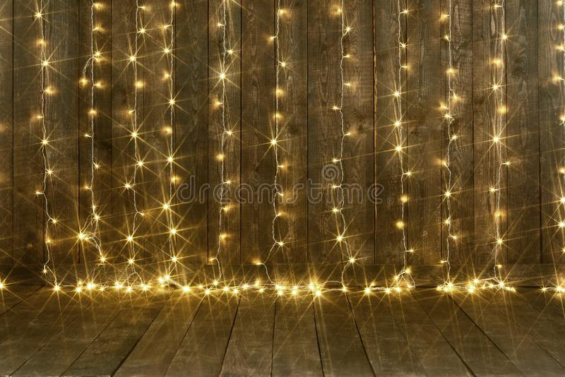 Dark wood background with lights, wall and floor, abstract holiday backdrop, copy space for text royalty free stock photos
