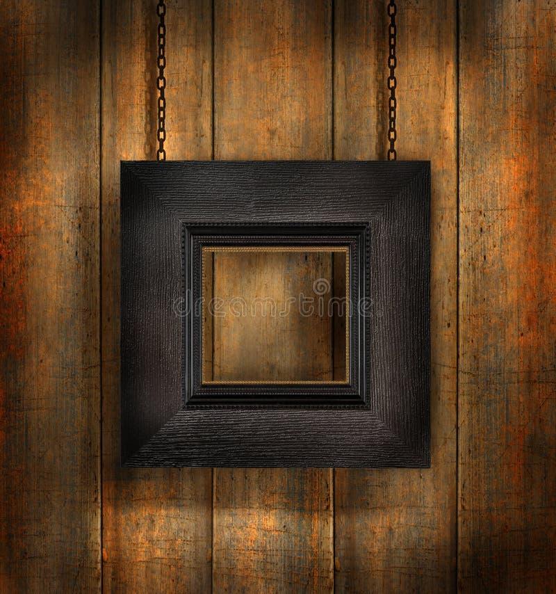 Dark wood frame against wood background stock photo