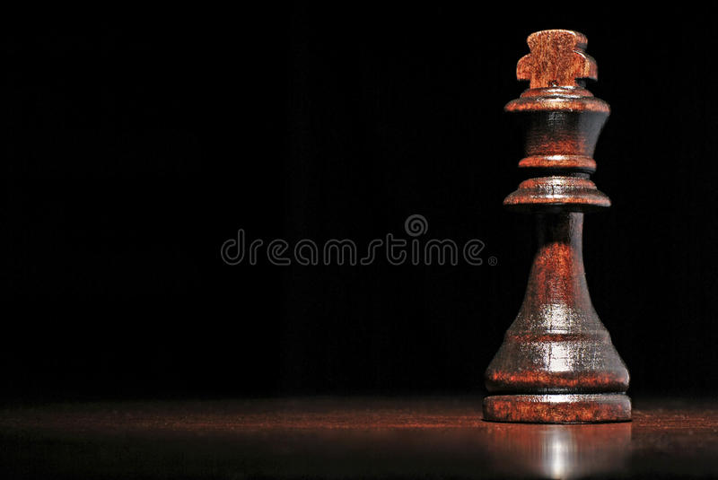 Dark wood king chess piece stock photos