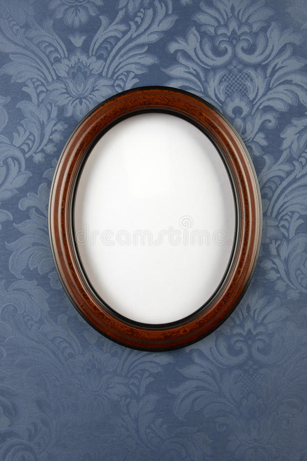 Dark wood oval wall frame royalty free stock photography