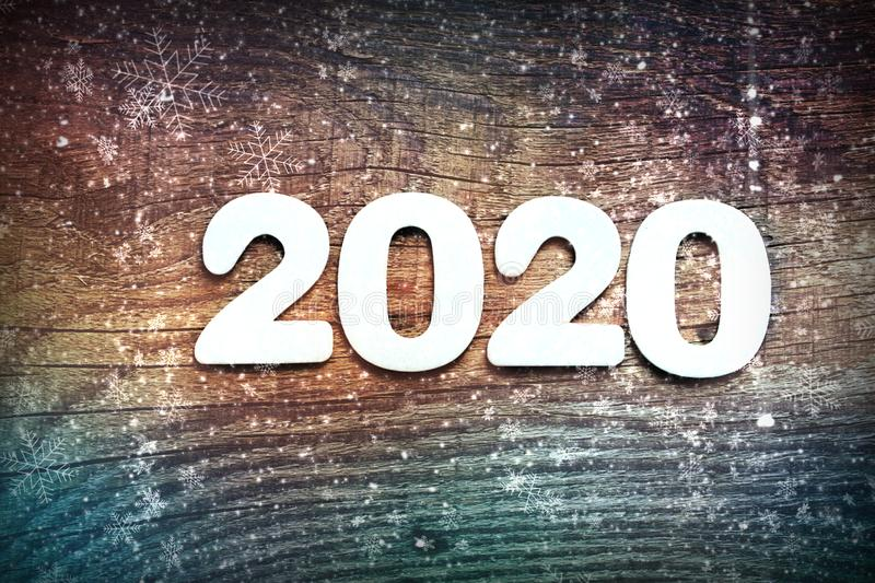 2020. Dark wood texture 2020.New year background. Retro wooden table. stock image