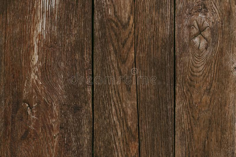 Dark wood timber background. Old wooden planks, texture. Cracked fence. Shabby desk surface. Brown oak boards. Vintage wall, patte stock image