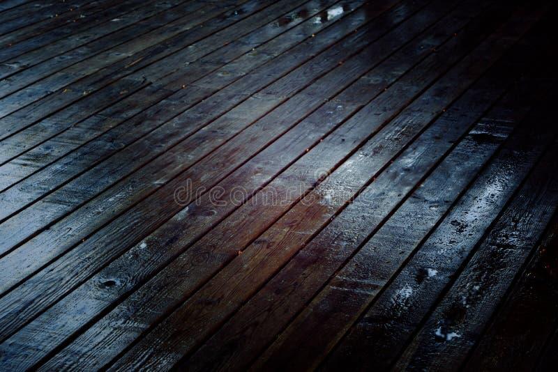 Dark wooden boards on a deck stock photos