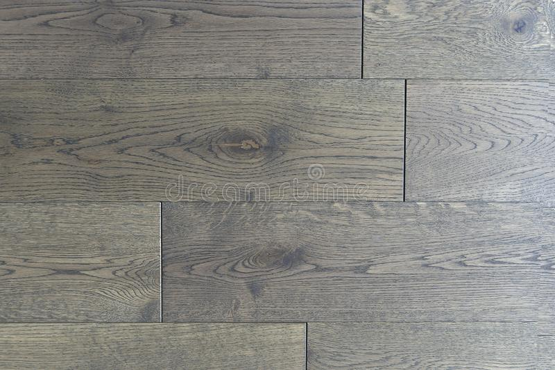 Dark wooden parquet floor background. Brown wooden background with a large natural wood texture, floor covering vertical. Layout stock images