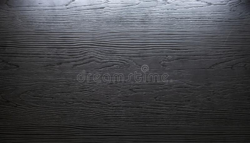 Dark wooden plank , deep texture with light. Background royalty free stock photos