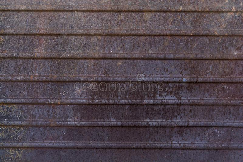 Dark worn rusty metal texture background royalty free stock photo