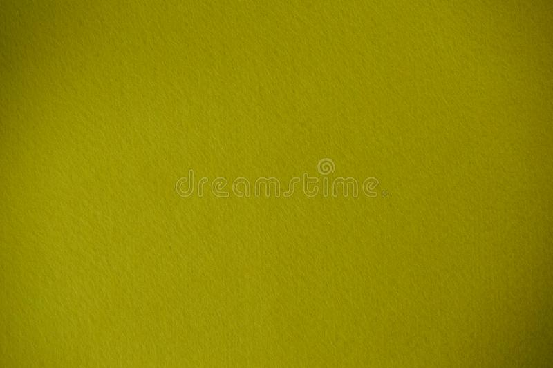 Dark yellow felt texture background the woven fabric isolated.  stock photography