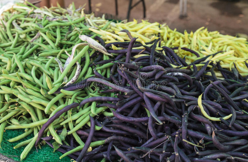 Dark yellow, purple and green beans royalty free stock image