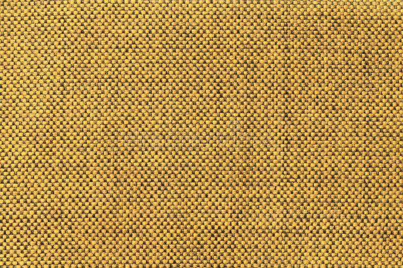 Dark yellow textile background with chess pattern, closeup. Structure of the fabric macro. Dark yellow background with checkered pattern, closeup. Structure of royalty free stock photos