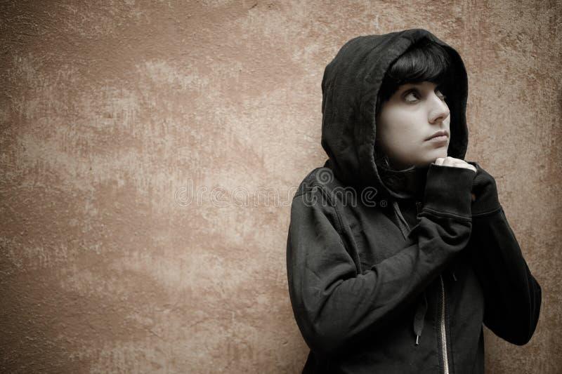 Download Dark Young Woman Sad Standing Near Urban Wall Portrait Stock Image