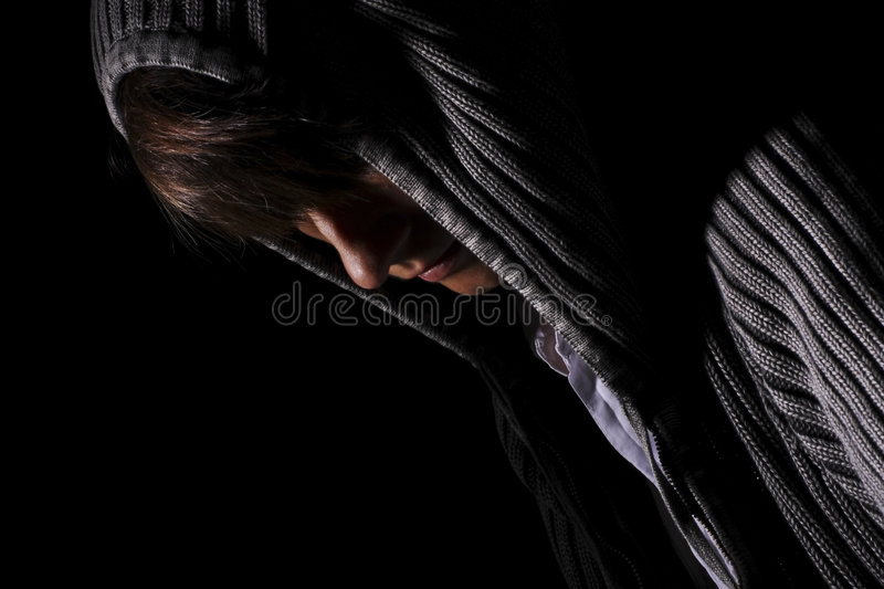 Darkened room. Person struggling with life and hiding away royalty free stock image