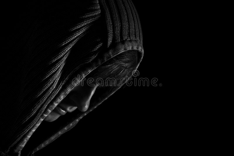 Darkened room. Person struggling with life and hiding away.use of negative space to create feeling of isolation stock photography