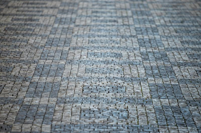 Darker and brighter cobble stones placed in geometric pattern in Prague old town.  royalty free stock images