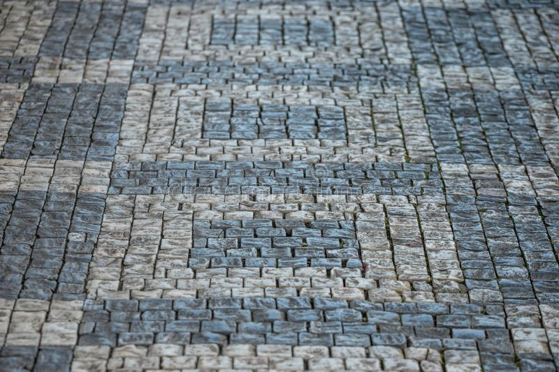 Darker and brighter cobble stones placed in geometric pattern in Prague old town.  stock image